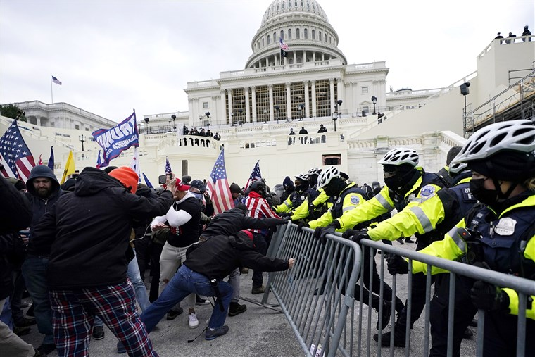 Capitol riot: Police officer dies amid pressure on Trump over inciting violence
